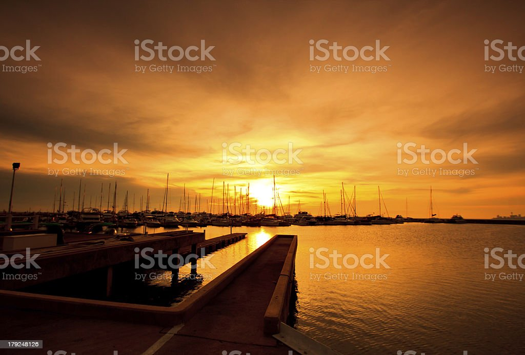 Yacht marina and sunset background royalty-free stock photo