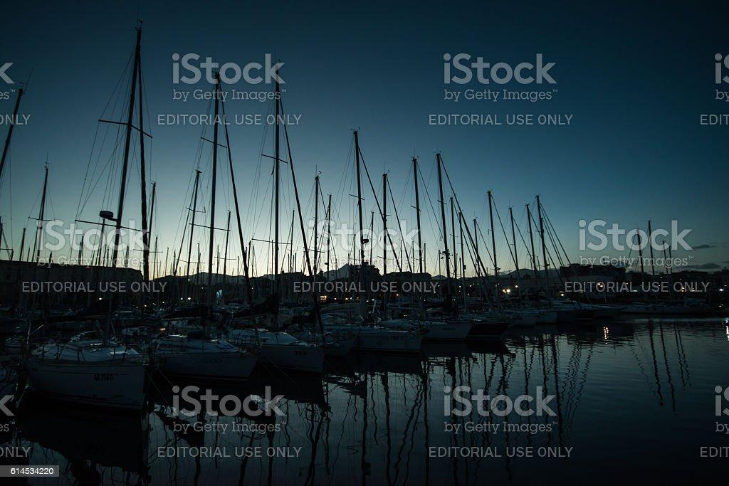Yacht masts against setting sun in Palermo Marina stock photo