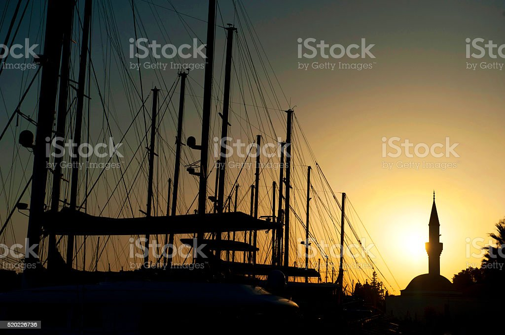 Yacht Masts against sunset sky in Bodrum Harbor stock photo