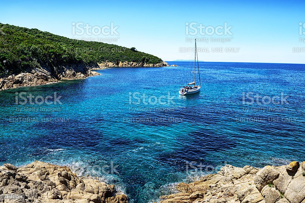Yacht moored in secluded bay  on Island of Elba stock photo