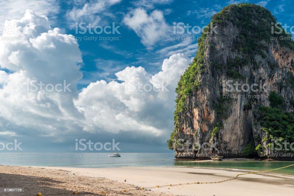 yacht near a rock in the Andaman Sea before the storm stock photo