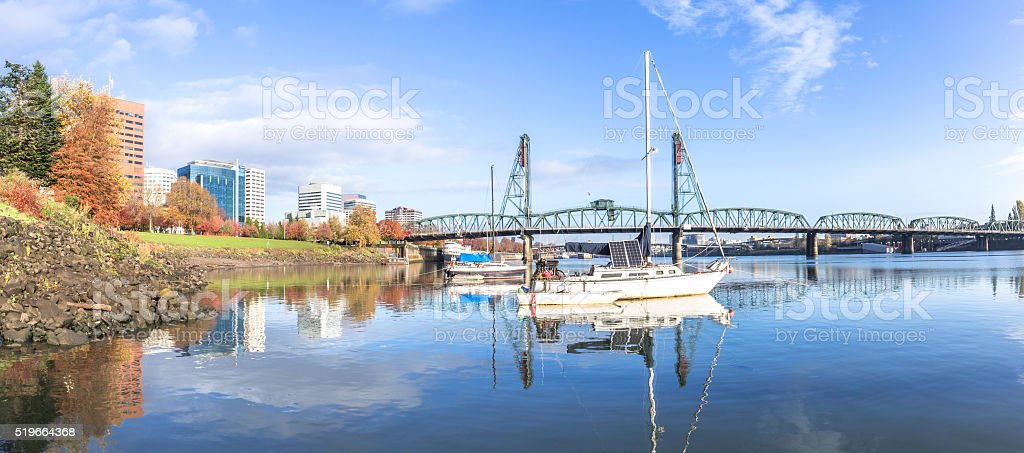 yacht on sea and bridge on water in blue sky stock photo