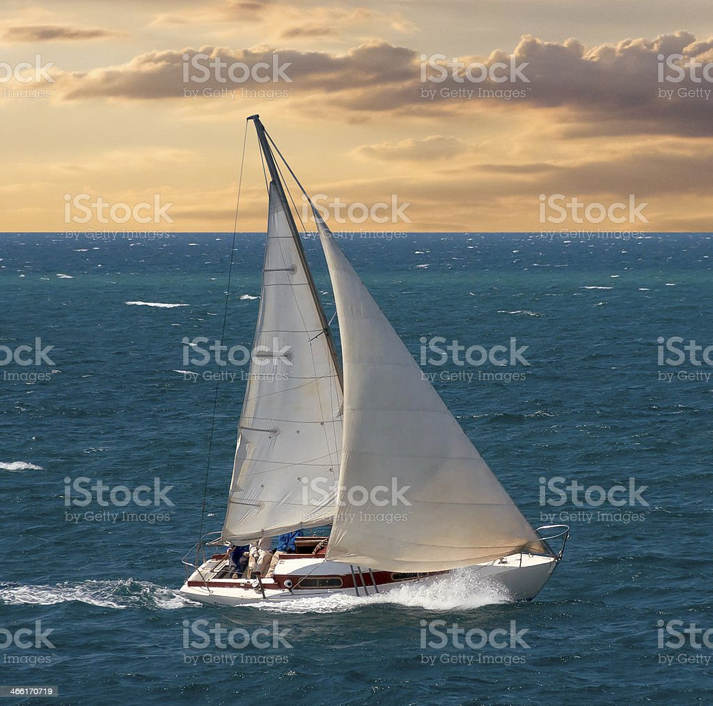 Yacht on sunset stock photo