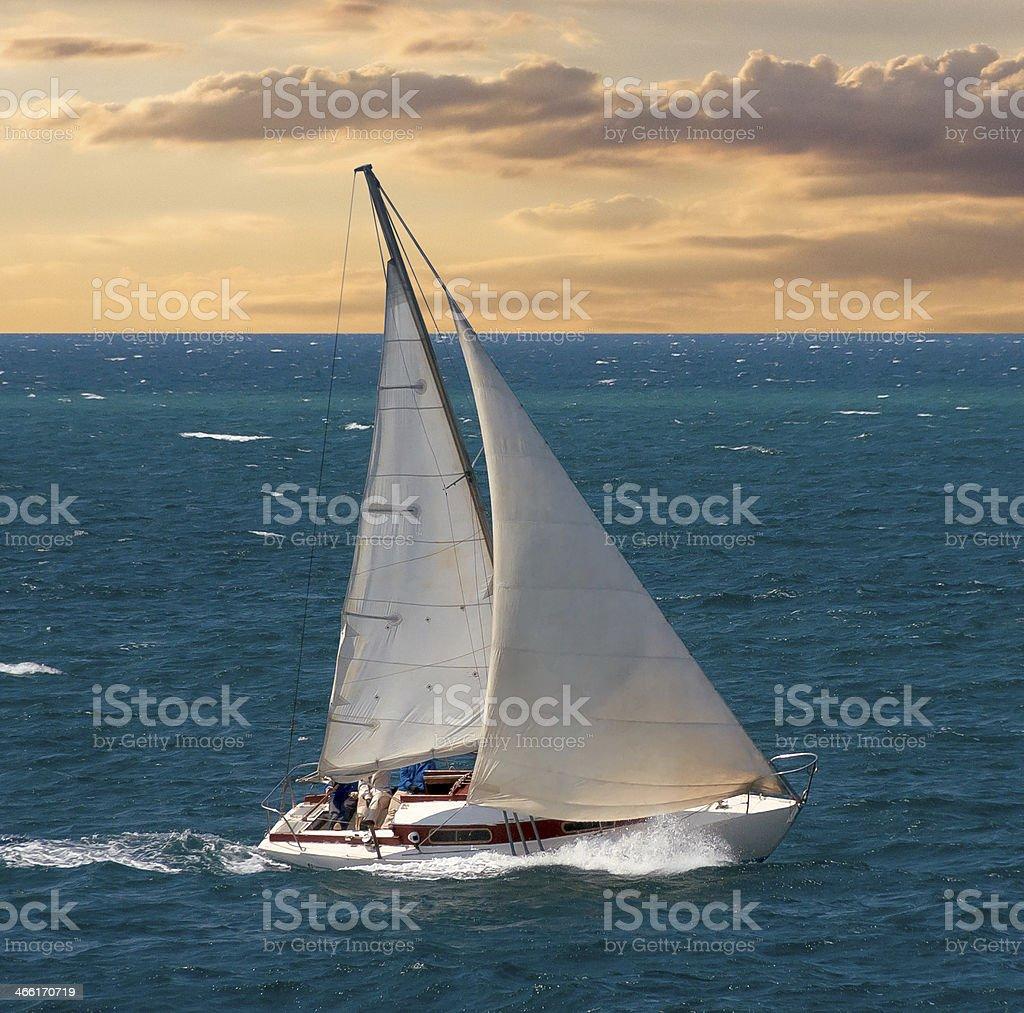 Yacht on sunset stock photo