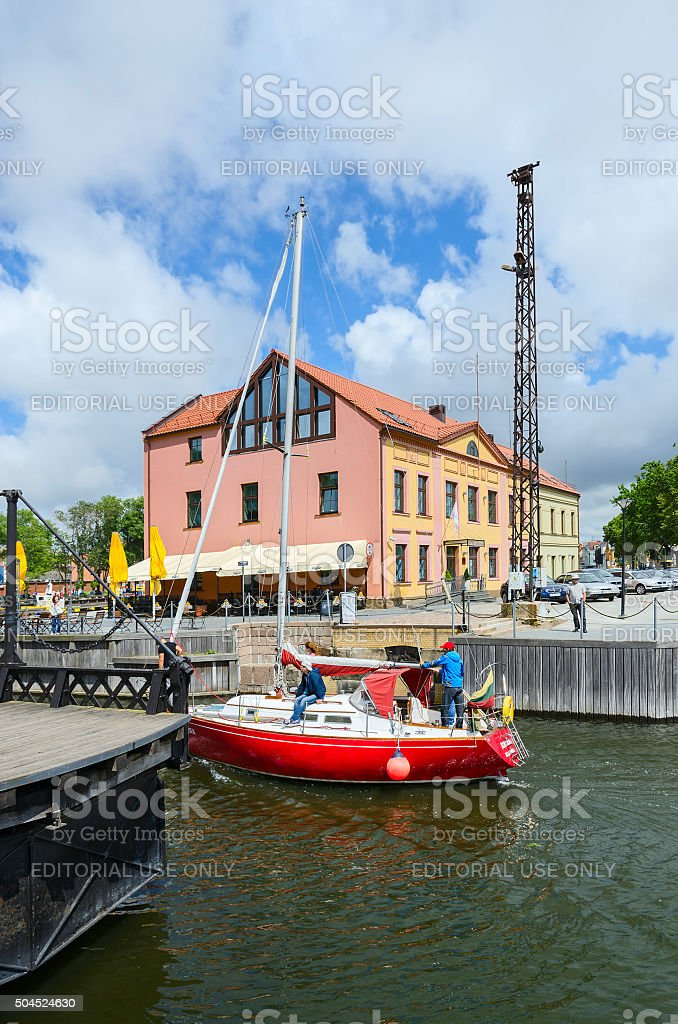 Yacht passes through moat of Dassel, Klaipeda, Lithuania stock photo