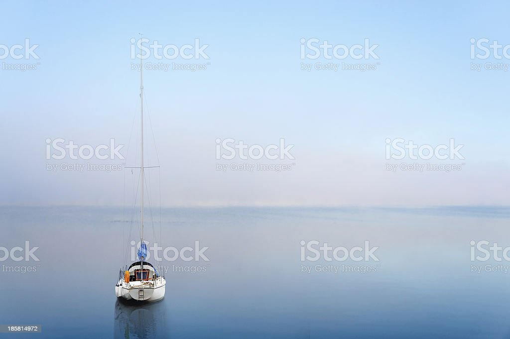 yacht reflected in calm water royalty-free stock photo