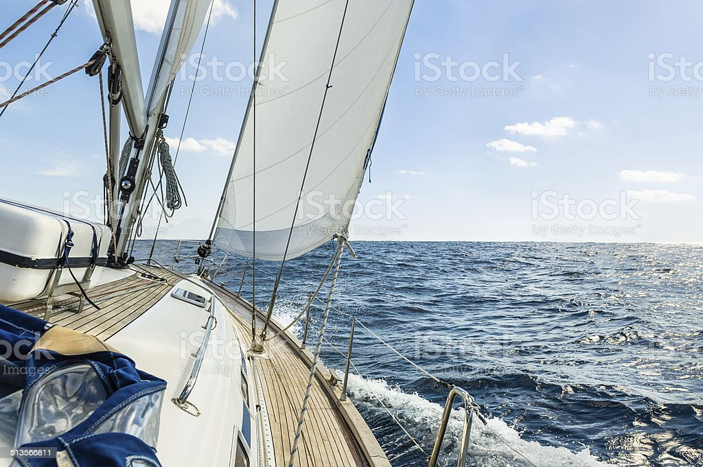 Yacht sail in the Atlantic ocean at sunny day cruise stock photo