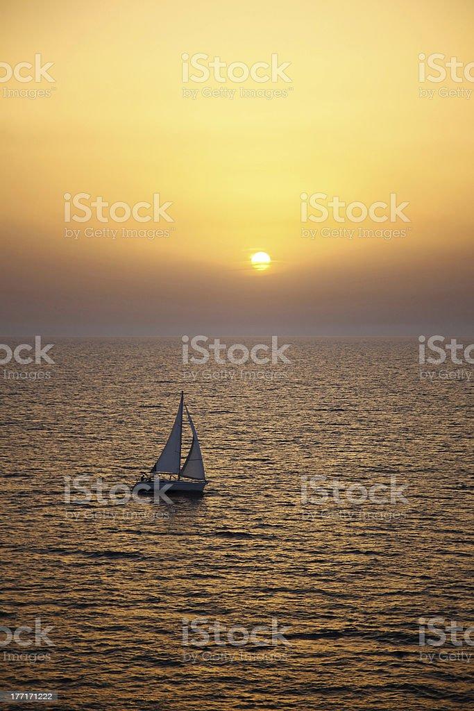 Yacht sailing at sunset royalty-free stock photo