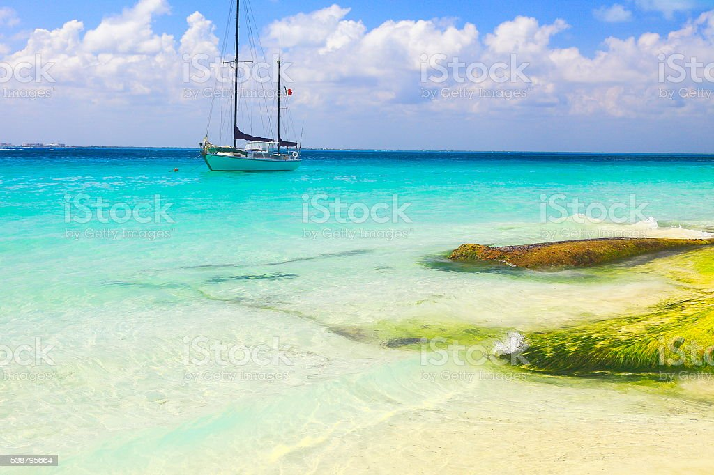 Yacht sailing, Cancun turquoise beach - caribbean tropical paradise stock photo