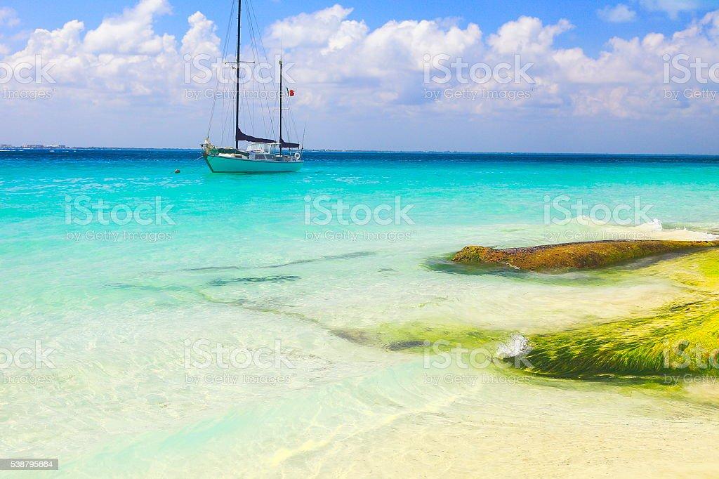 Yacht sailing, Cancun turquoise beach - caribbean tropical paradise stock photo