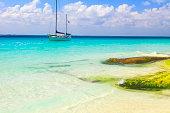 Yacht sailing, Cancun turquoise beach - caribbean tropical paradise
