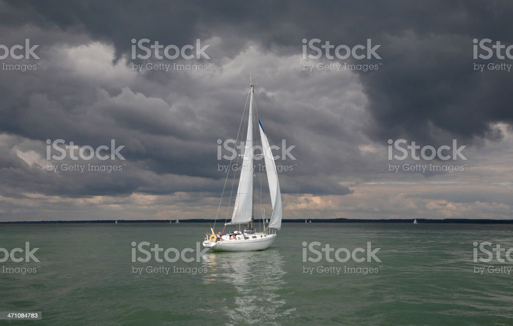 Yacht Sailing in a Calm Sea before the Storm royalty-free stock photo
