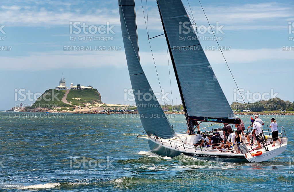 Yacht sailing on Newcastle Harbour, Australia stock photo