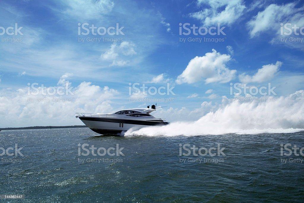 Yacht speeding in Miami stock photo