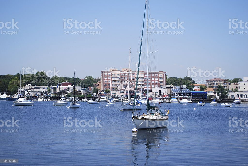 Yacht stationed in the water stock photo
