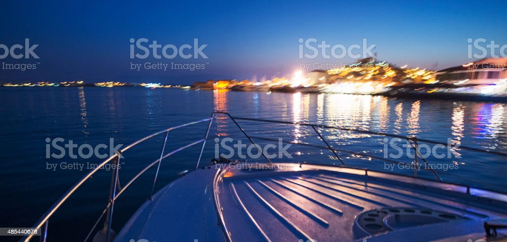 Yacht Traveling on The Sea at Early Morning ***Shaky Image*** stock photo
