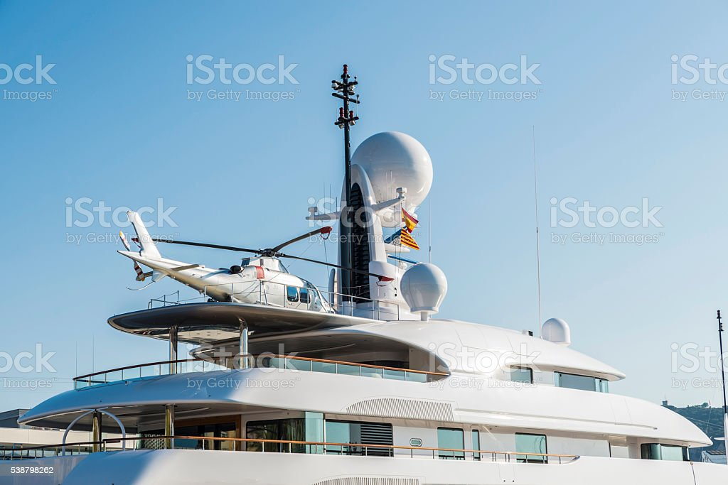 Yacht with a helicopter on its deck, Barcelona stock photo