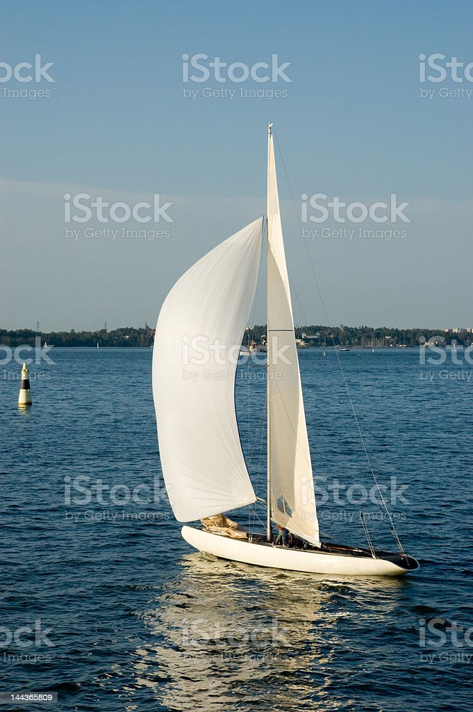 Yacht with a white sail in the gulf of Finland royalty-free stock photo