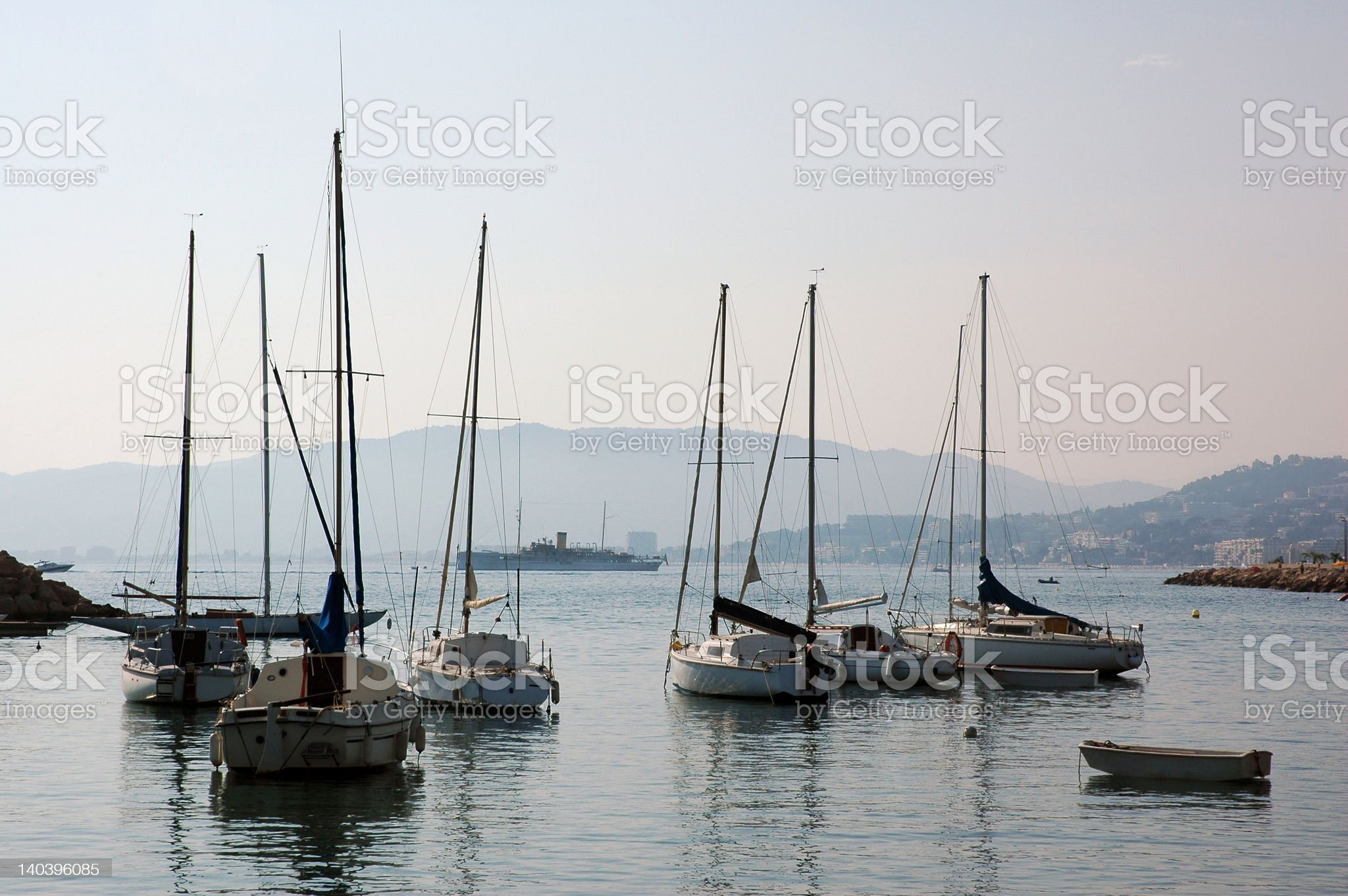Yachts anchored in quiet waters royalty-free stock photo