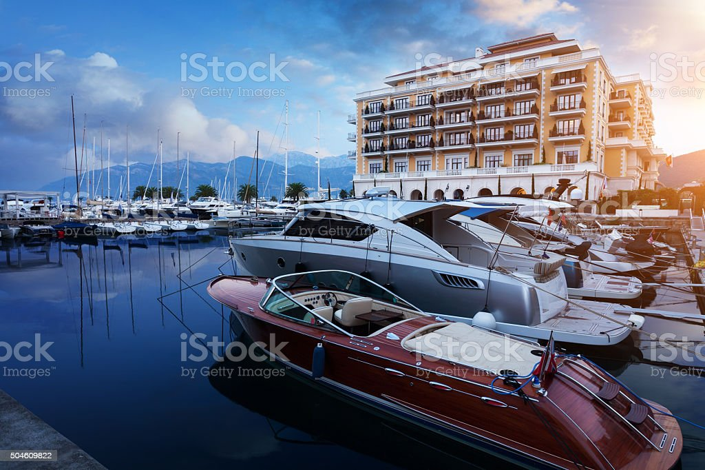 Yachts and boats at the pier of luxury hotel stock photo
