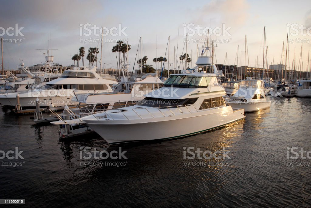 Yachts and Motorboats in Marina del Rey California at Sunset stock photo