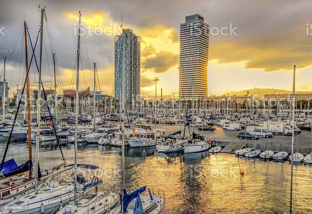 Yachts and sailboats with view to Skyscrapers Torre Mapfre stock photo