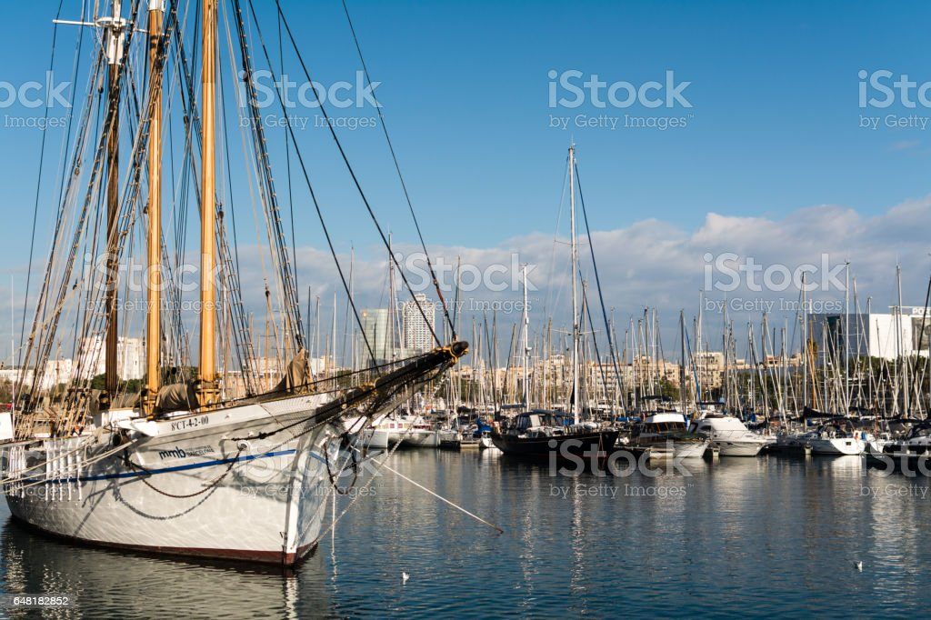 Yachts and sailing boats in harbor stock photo