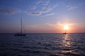 yachts at anchor in studland bay with sunrise