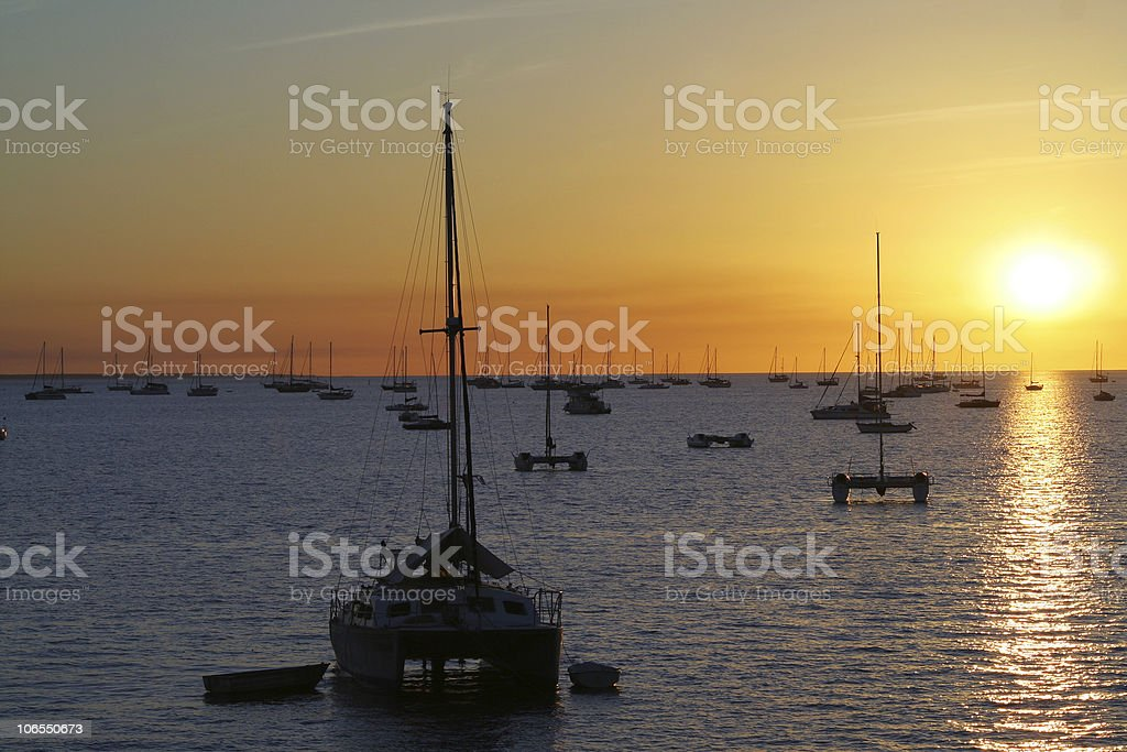 Yachts at sunset stock photo