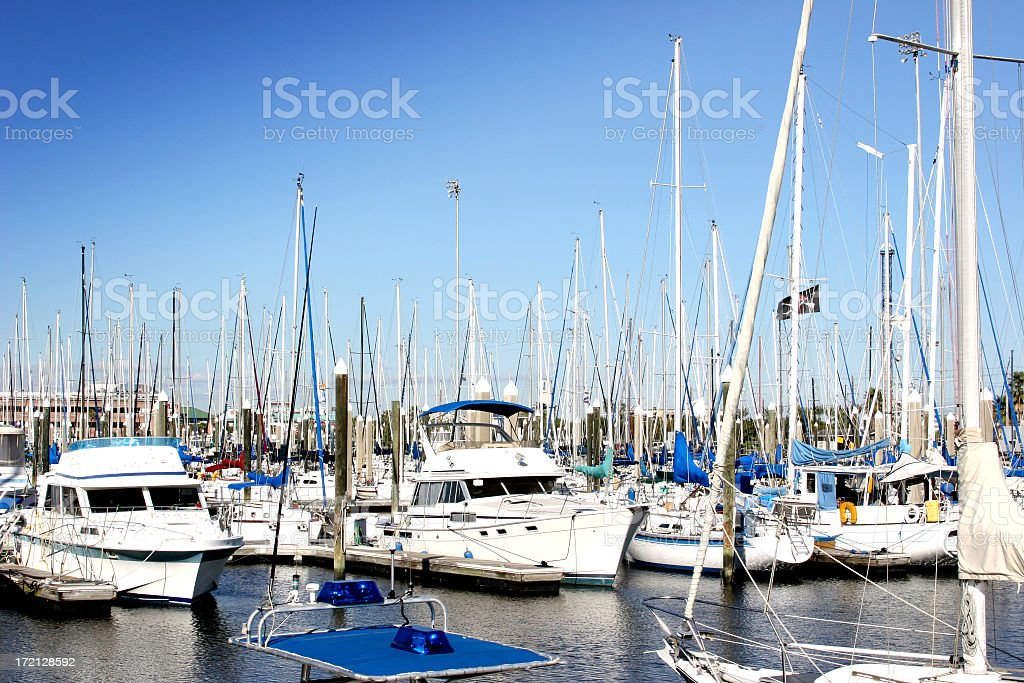 Yachts, boat dock marina. USA coast. Fishing boats. Harbor. Moored. royalty-free stock photo