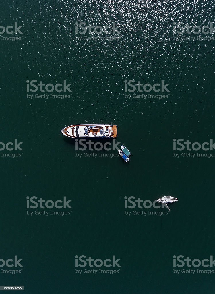 Yachts in azure sea stock photo