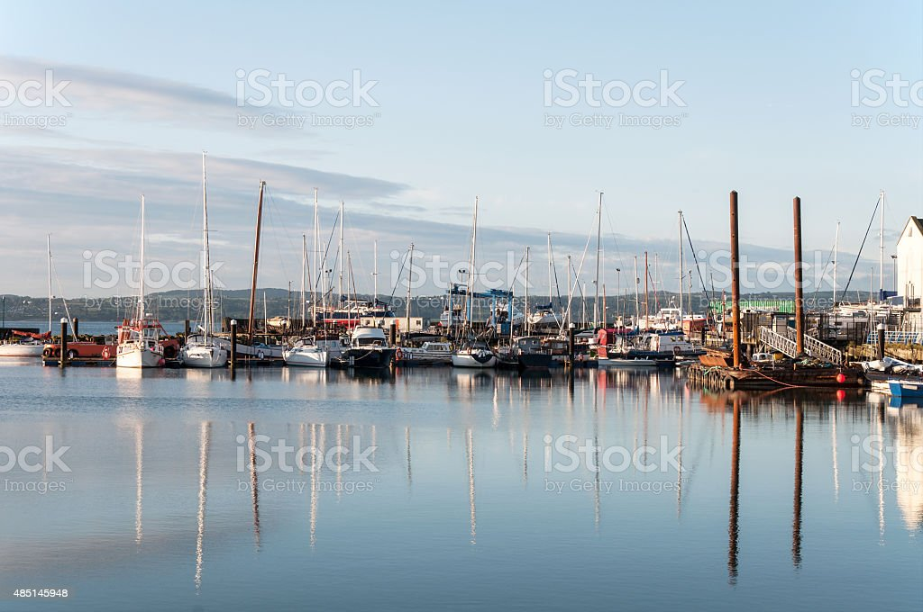 Yachts in marina at dawn stock photo