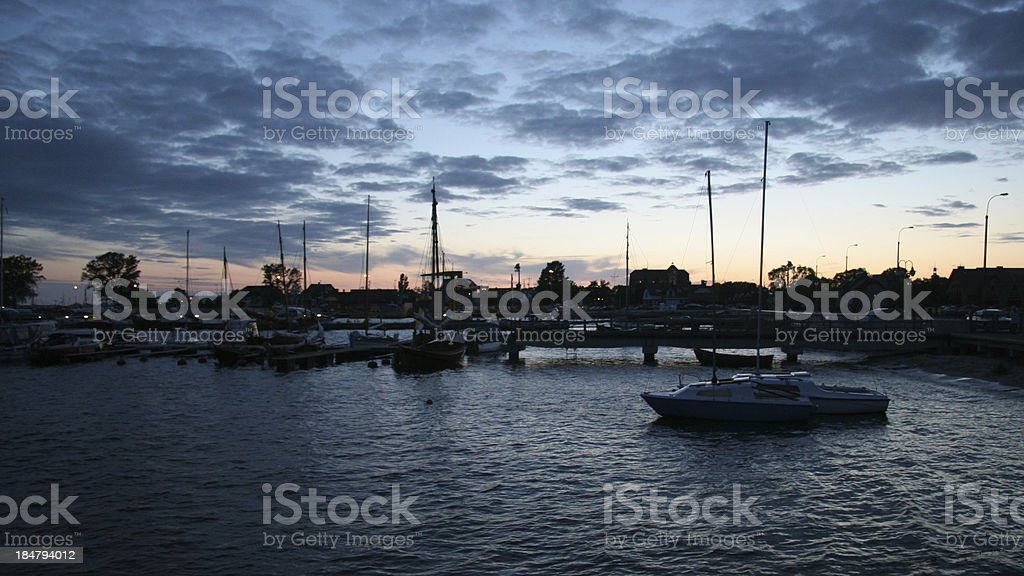 Yachts in marina during night royalty-free stock photo