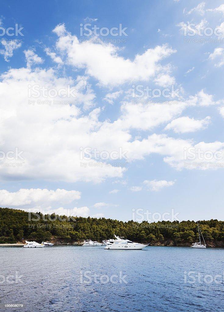 Yachts in the Island Bay. Sea. Summer Season. Moody sky. royalty-free stock photo