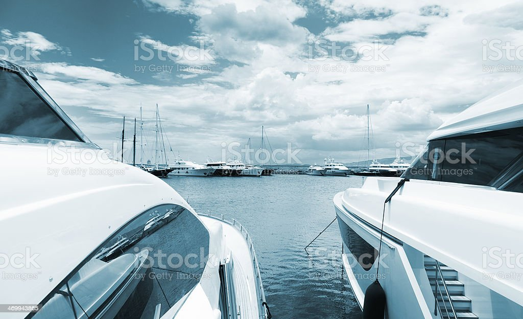 Yachts in the Marina. Summer season. Moody sky. royalty-free stock photo