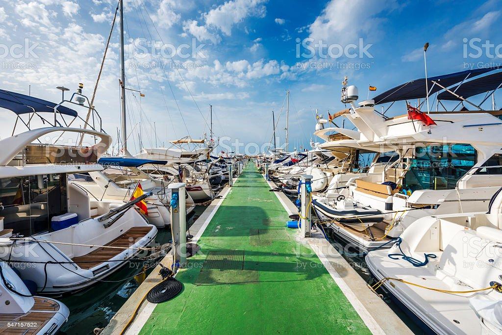 Yachts lined up along pontoon at marina of Puerto Portals stock photo