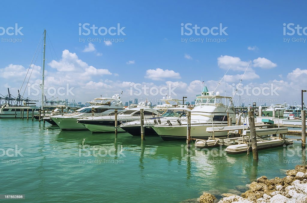 Yachts Moored a Harbour and Blue Sky stock photo
