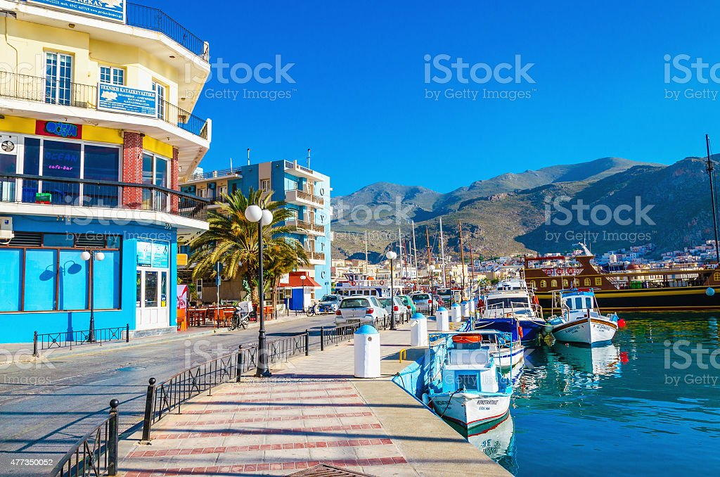 Yachts moored in port colorful buildings, Greece stock photo