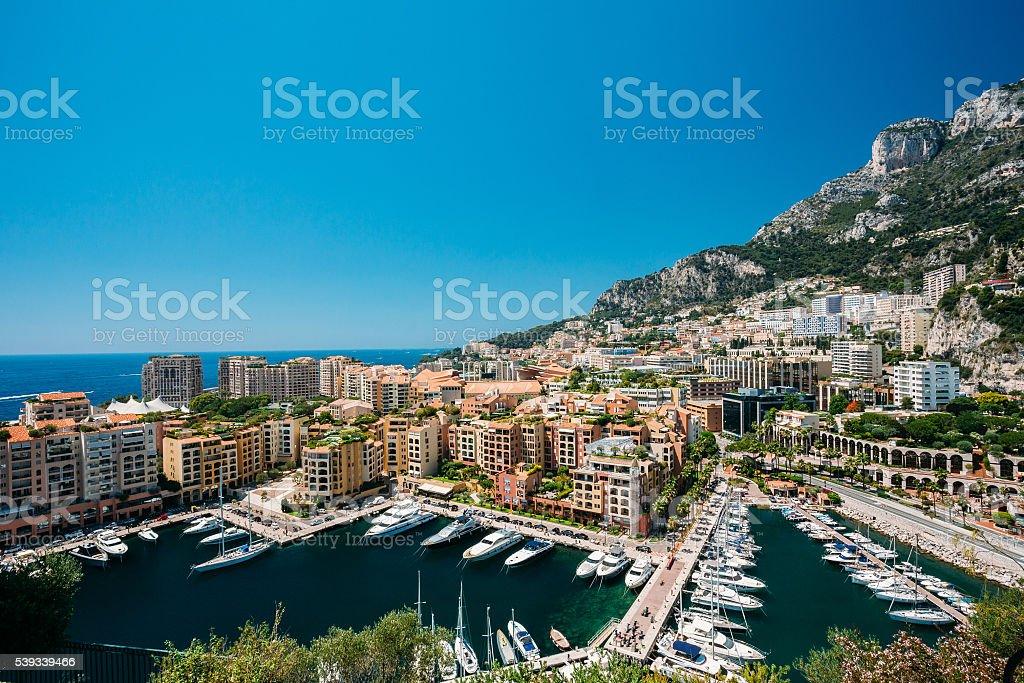 Yachts moored near city Pier, Jetty  Sunny Summer Day. Monaco, stock photo