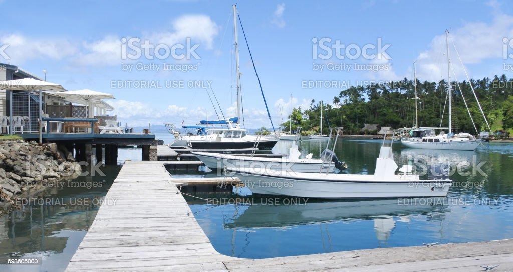 Yachts mooring in Copra Shed Marina Savusavu Fiji stock photo