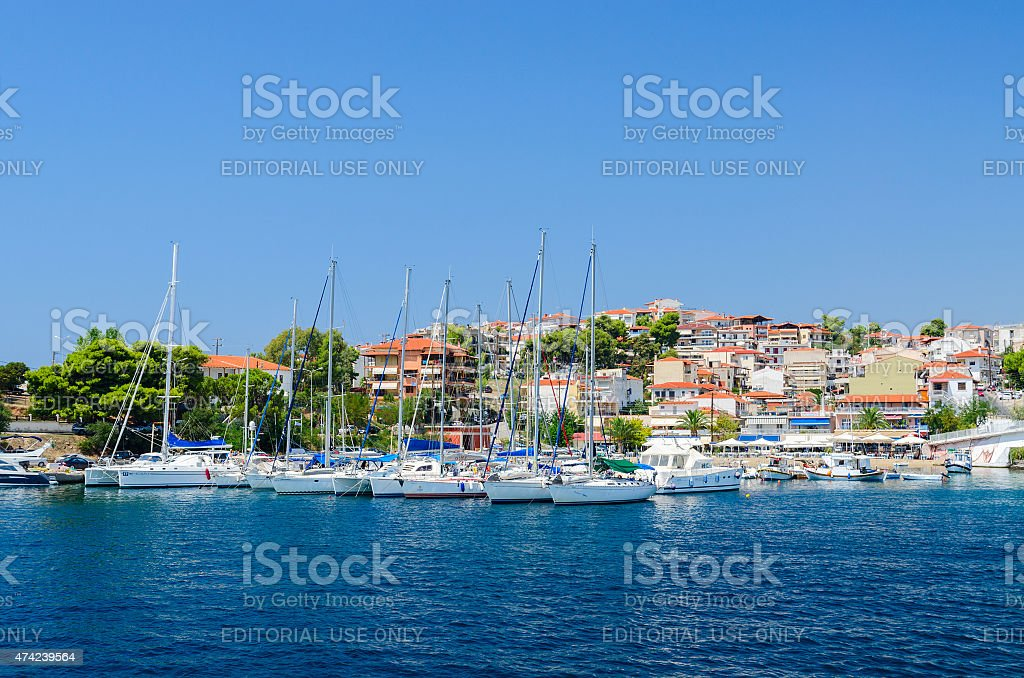 Yachts near pier of resort town Neos Marmaras, Sithonia, Greece stock photo