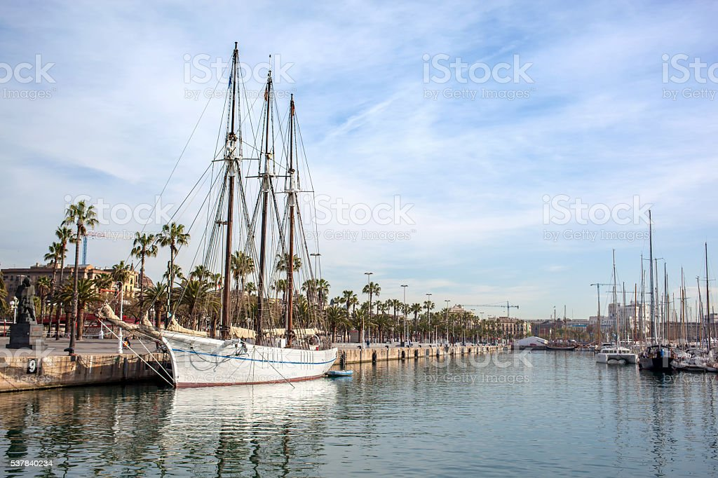 Yachts near Pier on calm water with reflecting stock photo