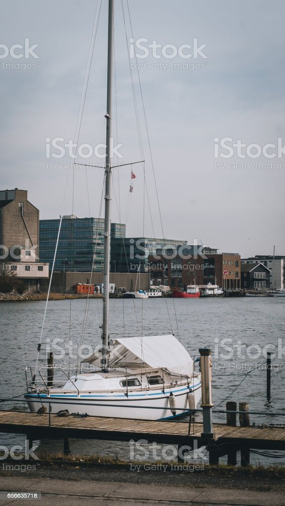 Yachts parked near a pear in the old part of town in Odense, Denmark stock photo