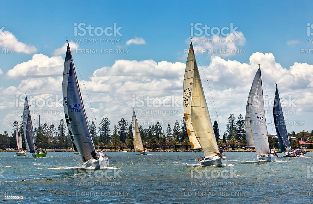 Yachts sailing on Newcastle Harbour, Australia stock photo
