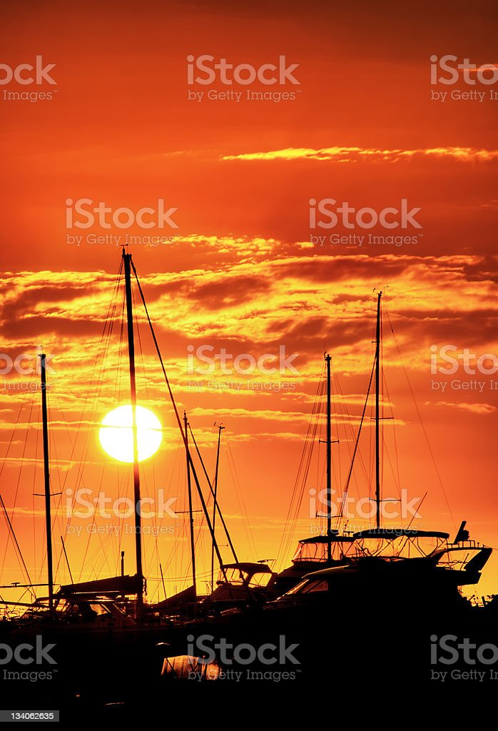 Yachts with Fiery Sunset royalty-free stock photo