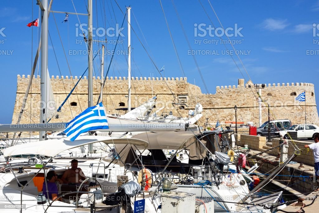 Yachts with Koules castle to the rear, Heraklion. royalty-free stock photo