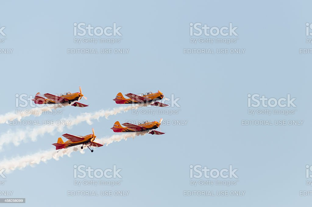 Yak-54 and 3 Yak-52 aircrafts fly against blue sky background royalty-free stock photo