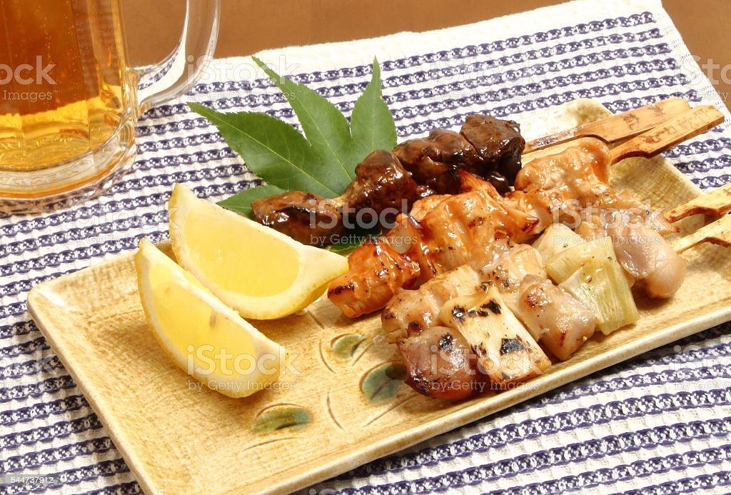 yakitori japanese grilled chiken with beer stock photo