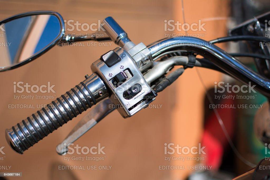 Yamaha DragStar motorcycle handle, photographed on a nice sunny day. stock photo