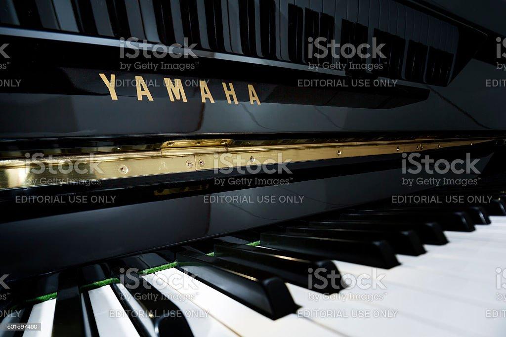 Yamaha vertical piano ebony and ivory keys stock photo